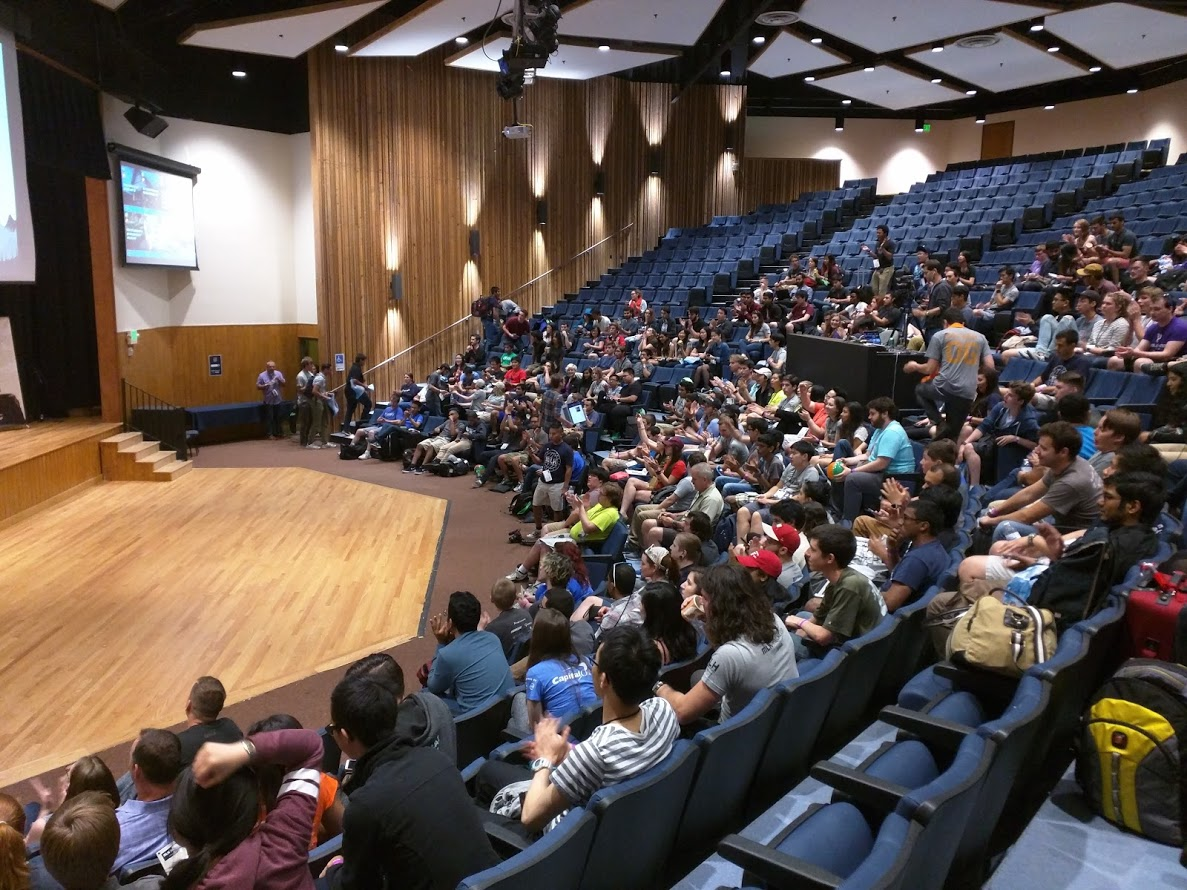 Hackers are trickling into the auditorium before the kickoff of Hackcon IV.